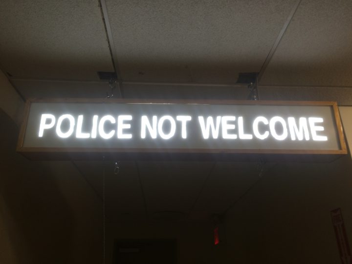 """Scott Daniel Williams's """"Storefront Sign for the Ungovernable City"""" (2016) reinstalled at the Loisaida Center (photo courtesy Atomic Culture)"""
