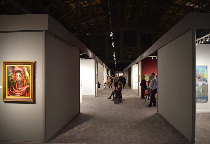 """One of the main aisles at the 2017 ADAA Art Show, with David Alfaro Siqueiros's """"La Patrona"""" (1939) in the Mary-Anne Martin Fine Art boot at left (all photos by the author for Hyperallergic)"""