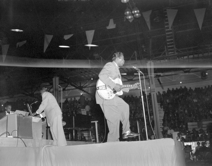 """Chuck Berry performing at the """"Biggest Show of Stars For '57"""" concert in Edmonton, Alberta (Richard G. Proctor Photography Limited fonds, Provincial Archives of Alberta, via Wikimedia Commons)"""