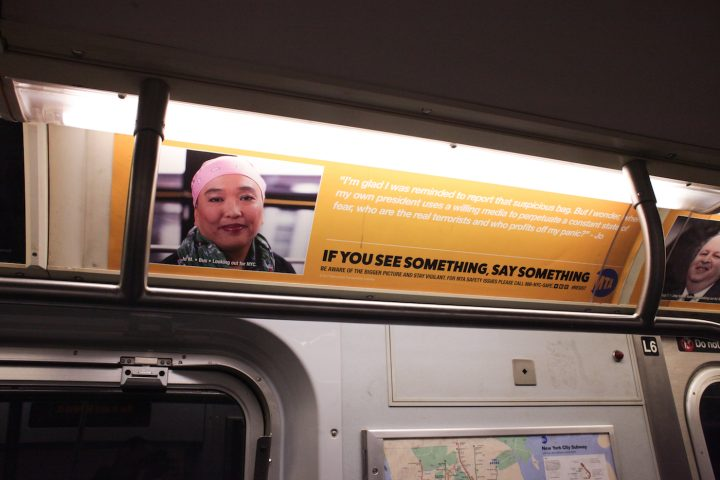 """One of the substitute MTA ads, which reads: """"I'm glad I was reminded to report that suspicious bag. But I wonder, when my own president uses a willing media to perpetuate a constant state of fear, who are the real terrorists and who profits off my panic?"""" (all photos courtesy the artist)"""