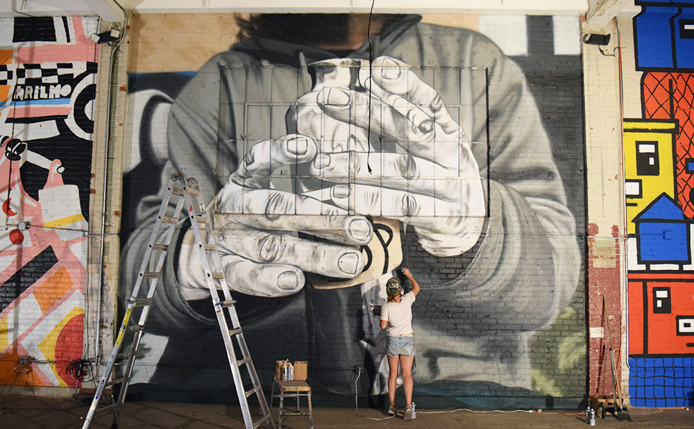 BKFOXX mural in progress at Market Surplus