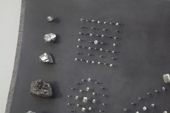 "Detail of John Stoney, ""Gems"" (2017), elemental aluminum, antimony, bismuth, cadmium, indium, iron, lead, nickel, silver, tin, zinc, felt, 40 1/2 x 48 x 9 1/2 in"