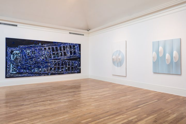Installation view of Beyond the Canvas: Contemporary Art from Puerto Rico at the Newcomb Art Museum with works by Arnaldo Roche-Rabell (left) and Zilia Sánchez (right)