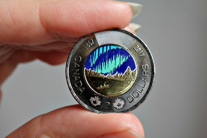 """The """"Dance of the Spirits"""" glow-in-the-dark coin from the Royal Canadian Mint (photo by the author for Hyperallergic)"""