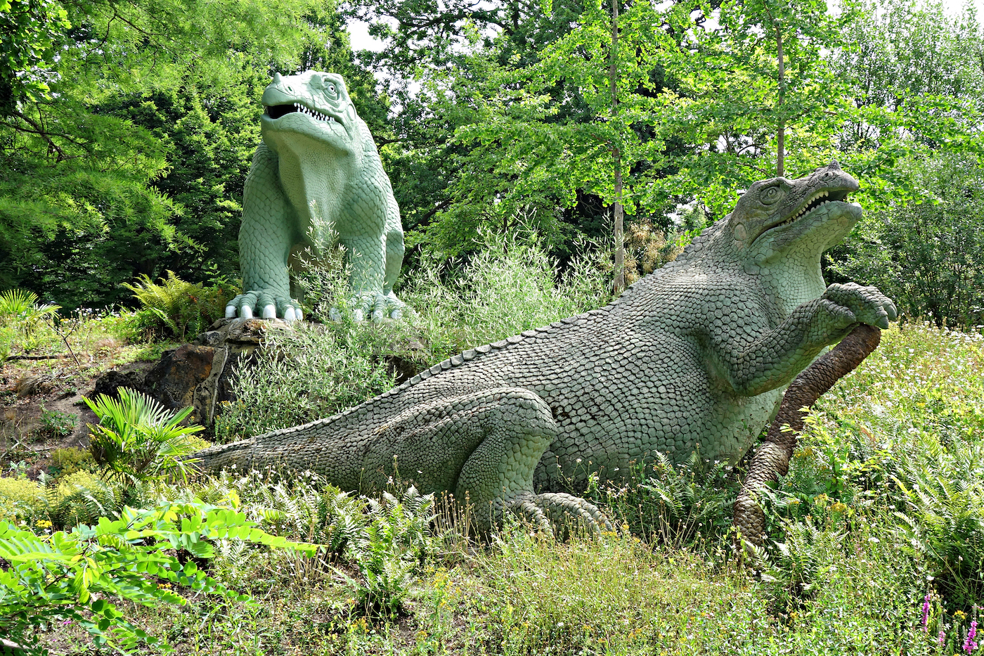 Dinosaur sculptures in Crystal Palace Park, London (photo by the author for Hyperallergic)
