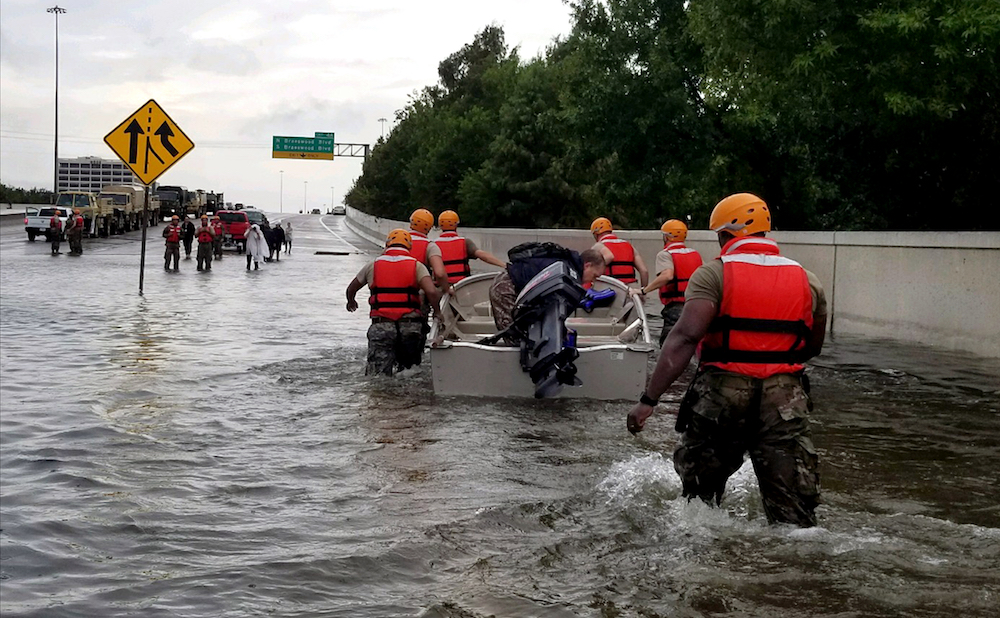 Soldiers with the Texas Army National Guard move through flooded Houston streets as floodwaters from Hurricane Harvey continue to rise on Monday, August 28, 2017. (US Army photo by 1st Lt. Zachary West, via Wikimedia Commons)