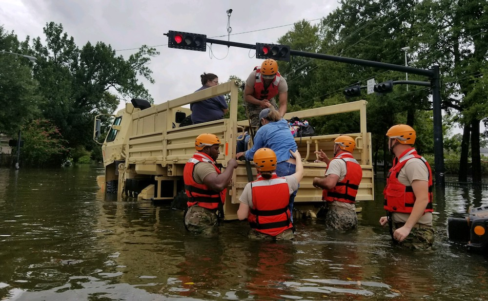 Texas National Guard soldiers conduct rescue operations in flooded areas around Houston, Texas, on August 27, 2017. (photo by 1Lt. Zachary West, 100th MPAD; courtesy Texas National Guard, via Wikimedia Commons)