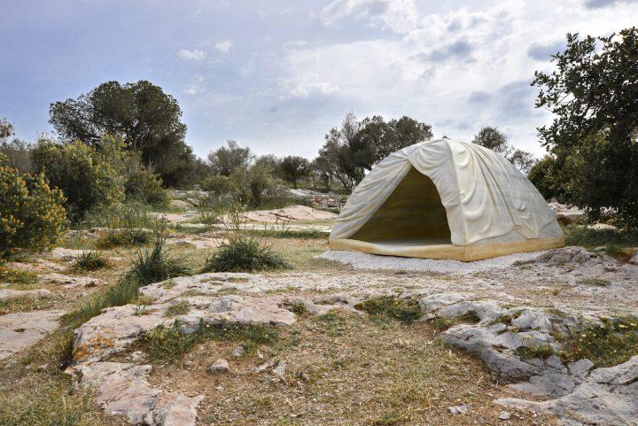"Rebecca Belmore, ""Biinjiya'iing Onji (From inside)"" (2017), marble, Filopappou Hill, Athens for Documenta 14 (photo by Fanis Vlastaras, courtesy Documenta)"