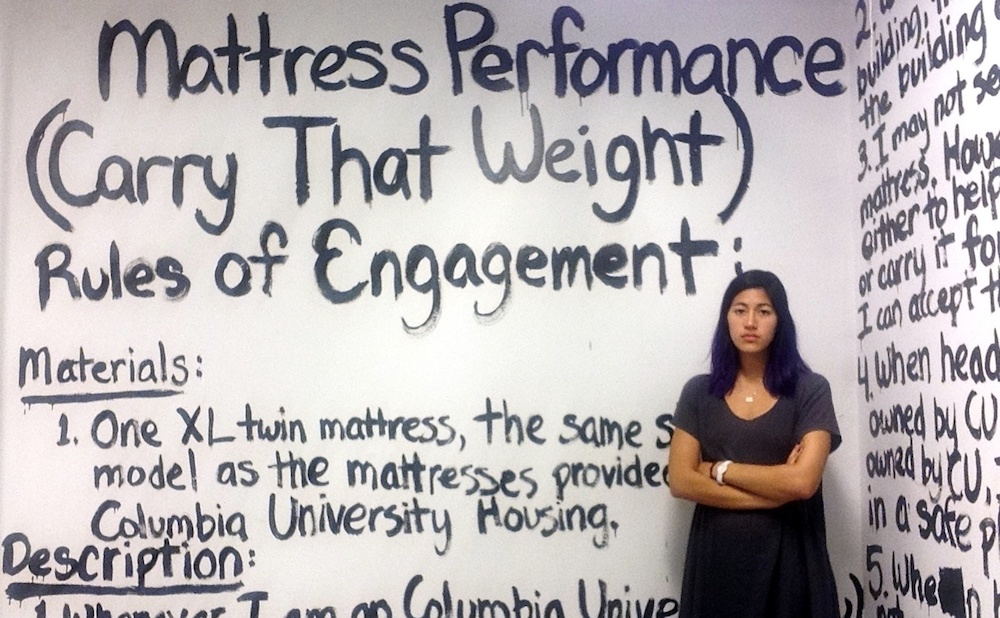 """Emma Sulkowicz and the rules of engagement of """"Mattress Performance (Carry That Weight)"""" (2014–15) (via Wikimedia Commons)"""