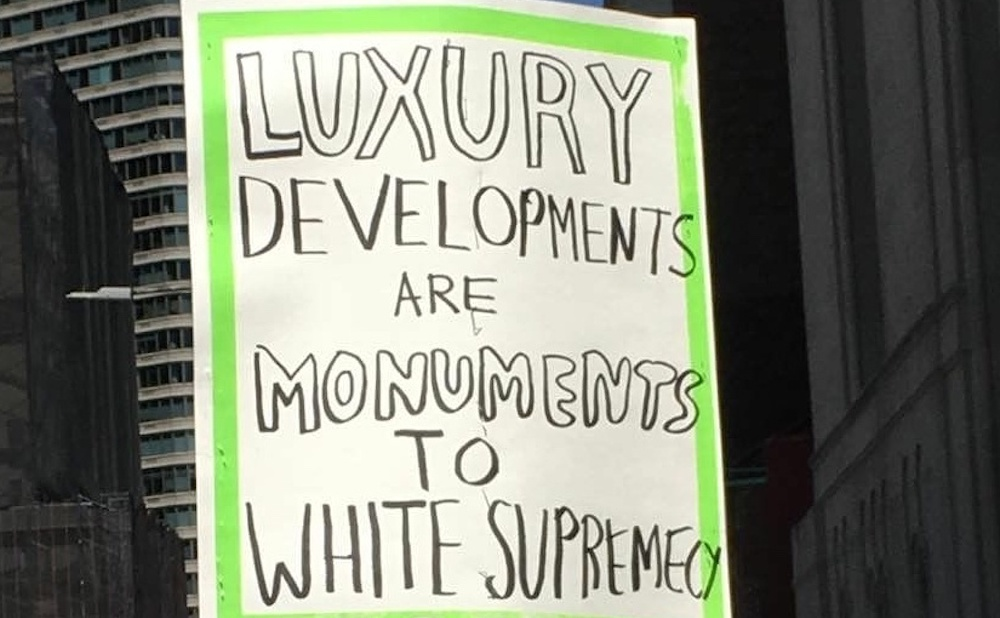 A People's Cultural Plan sign at a protest