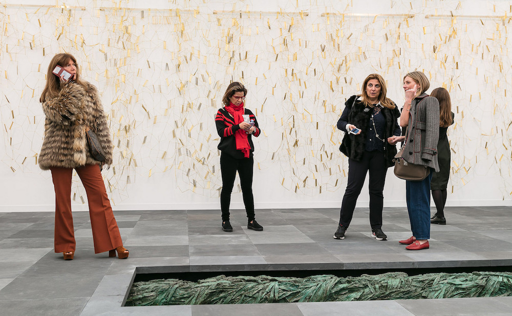Installation view of Marian Goodman's booth at Frieze London 2017, with Leonor Antunes's bronze curtain sculpture in the background (photo by Mark Blower; courtesy of Mark Blower/Frieze)