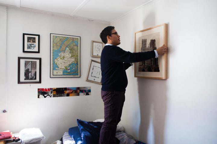 A Williams College Student Hanging Work On Loan From The Walls Program In His Dorm