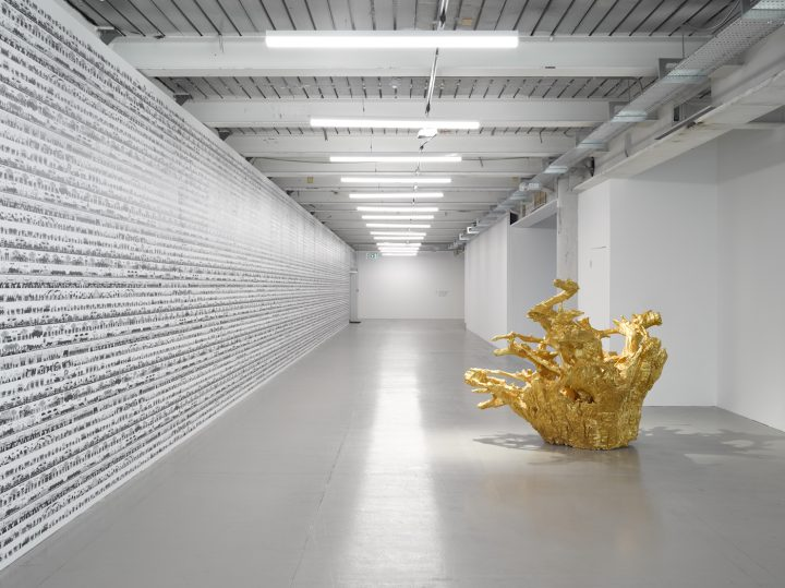 """Ai Weiwei, wall Work: """"Odyssey"""" (2016); floor works: """"Iron Tree Trunk"""" (2015), """"Iron Root"""" (2015) (photo by Jack Hems, © Ai Weiwei, courtesy Lisson Gallery)"""
