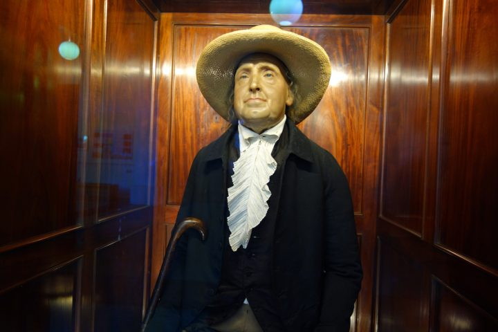 The auto-icon of Jeremy Bentham, containing the philosopher's skeleton in his clothes with a wax head, at University College London (all photos by the author for Hyperallergic unless noted)