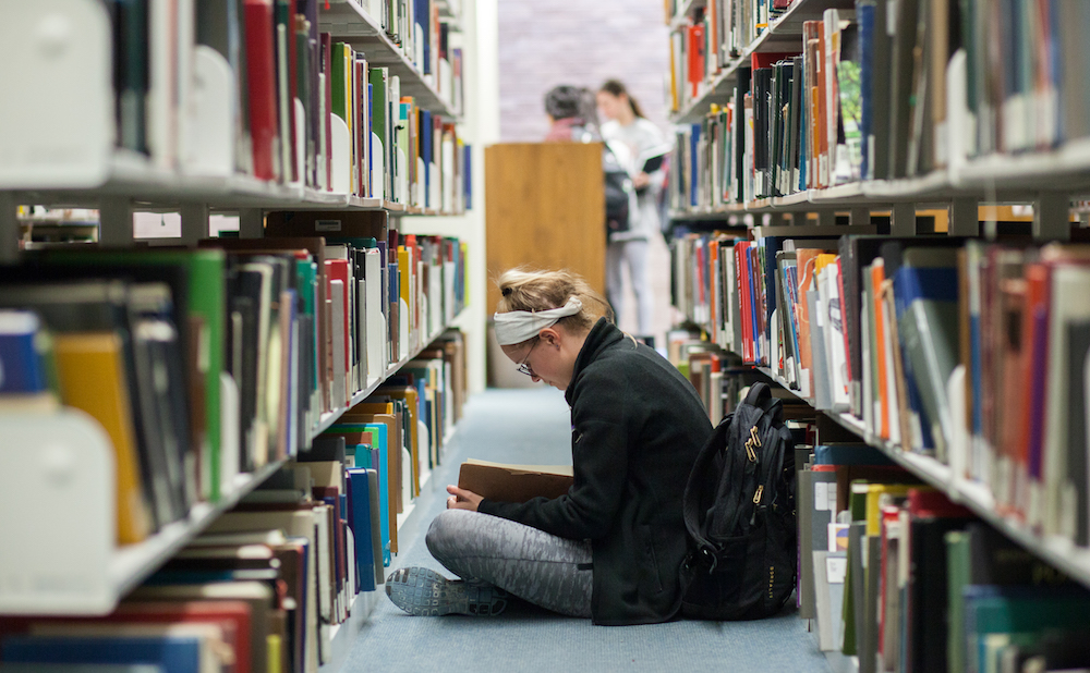 A student in the stacks of the Fine Arts Library at the University of Texas, Austin (courtesy University of Texas Libraries, the University of Texas at Austin)