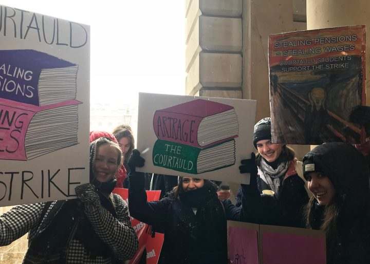 Art students and faculty with placards in support of the University and College Union strike