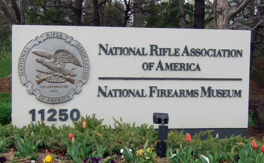 The sign for the National Rifle Association headquarters and National Firearm Museum in Fairfax, Virginia (photo by Joe Loong/Flickr)