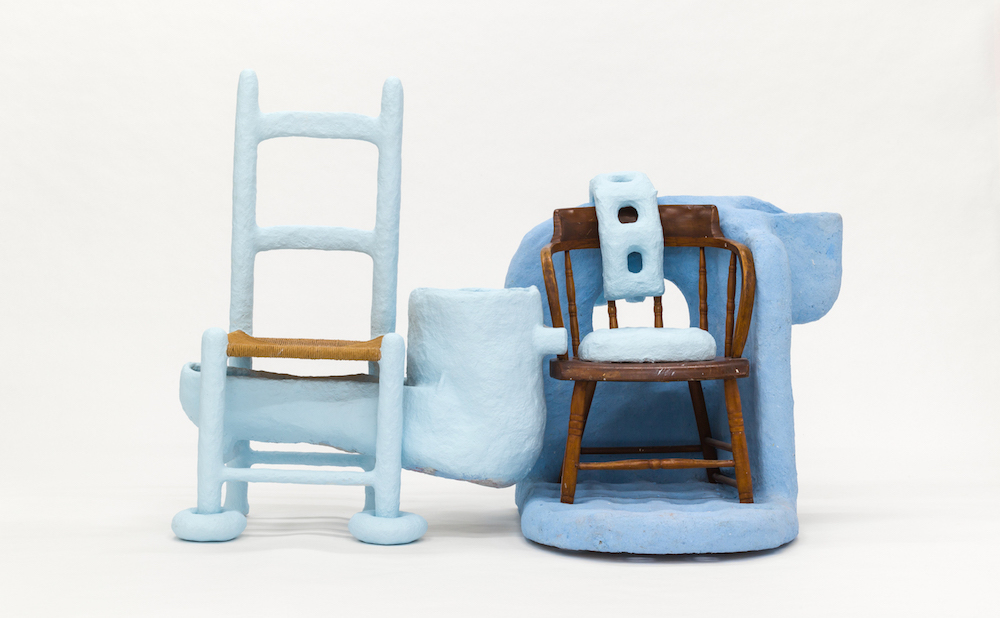 """Thomas Barger, """"Love Me, Protect Me Chair"""" (2018), paper pulp, plywood, two wooden chairs, polyurethane, and paint, 44 x 60 x 38 in"""