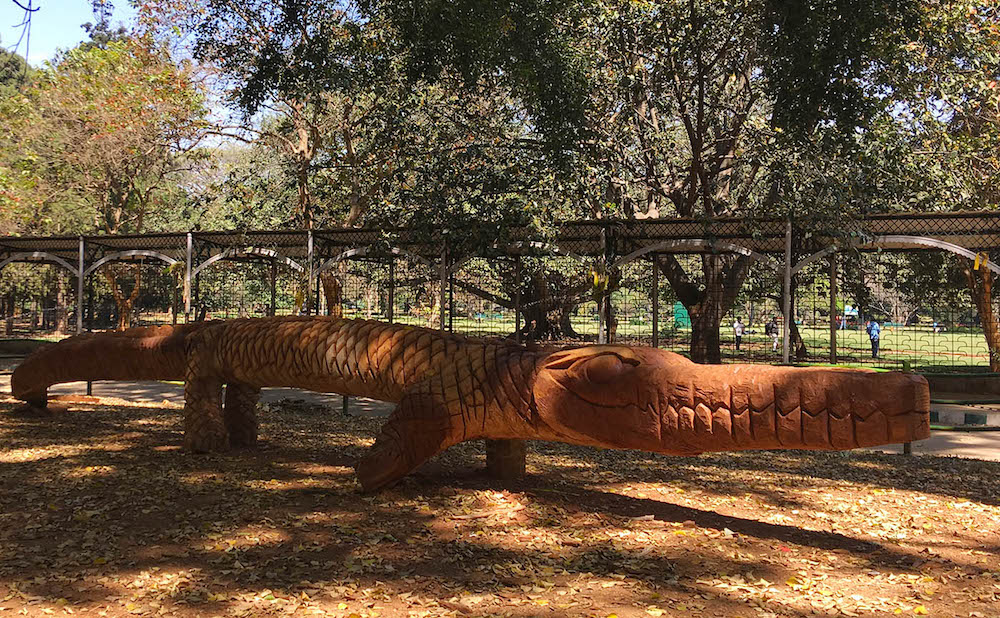 A sculpture carved from the trunk of a felled tree in Lalbagh Botanical Gardens