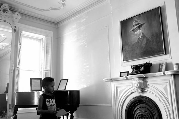 Zion (age 6) sharing a poem in the Summer Block Party in the Langston Hughes House (courtesy of I, Too Arts Collective; photo by David Flores)