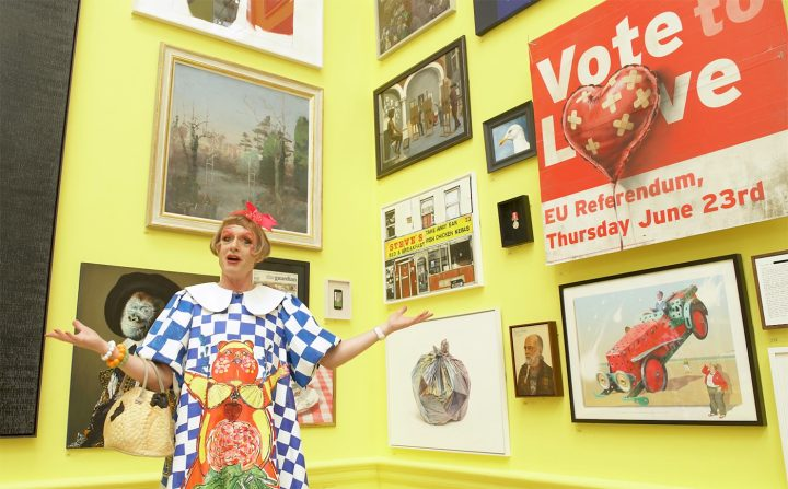 Grayson Perry alongside the Banksy artwork in the Royal Academy's 2018 summer exhibition (screenshot by the author via Vimeo)