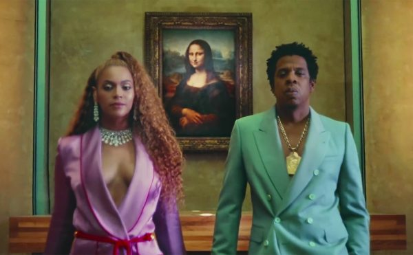 """Beyoncé and Jay-Z in front of Leonardo da Vinci's Mona Lisa in the video for """"Apeshit"""" (all screenshots by the author via YouTube)"""