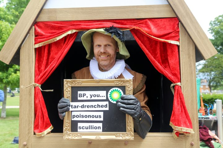 A visitor inside the Shakespearean Insult Booth (photo by Diana Moore)