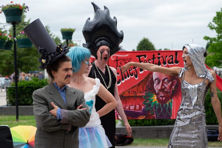 Lip Sync for our Lives in action. The House of Fossil Fools are not pleased to be challenged. (photo by Ron Fassbender)