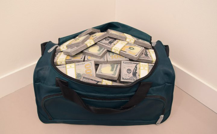 """Matt Johnson, """"Movie Money (1.75 Million Dollars in a Gym Bag)"""" (2018), carved wood with paint, 13 x 21 x 15 in, in 303 Gallery's booth at Frieze New York 2018 (photo by the author for Hyperallergic)"""