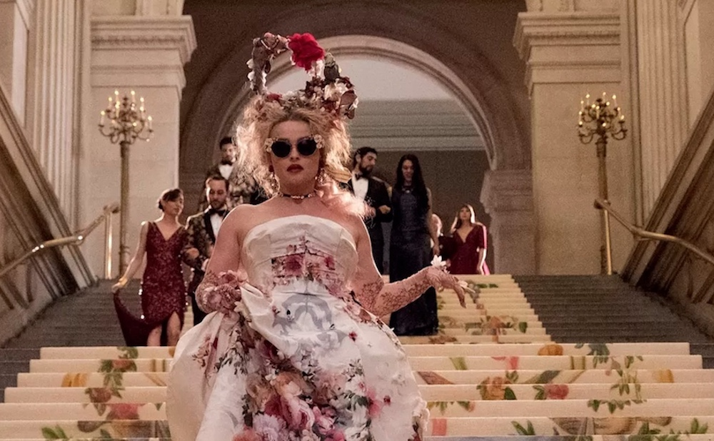 Helena Bonham Carter descends the Metropolitan Museum's main staircase in a scene from Ocean's 8 (image courtesy of Warner Bros. Entertainment Inc.)