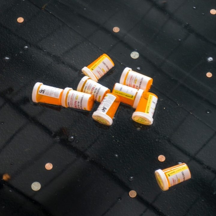 Sackler-branded pill bottles in the Sackler Wing's reflecting pool at the Metropolitan Museum during a protest in March (photo by Tim Davis)