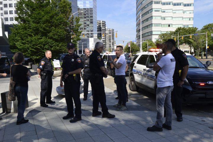 The Stamford Police Department talks to artist Domenic Esposito and gallerist Fernando Luis Alvarez (photo by Brian F. O'Neill, 2018)