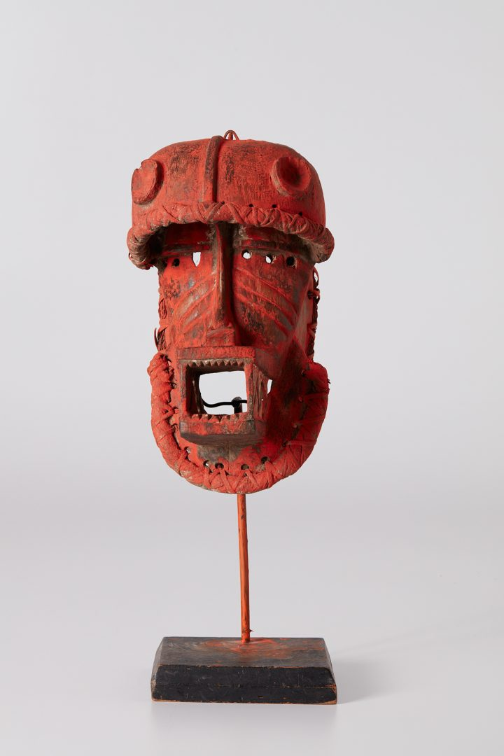 """David Hammons, """"Untitled"""" (2017), wooden mask, acrylic, wicker, straw, metal and wood base, mask 15 x 7 3/4 x 10 1/2 inches, overall 23 1/4 x 8 x 10 1/2 inches (image courtesy Phillips)"""