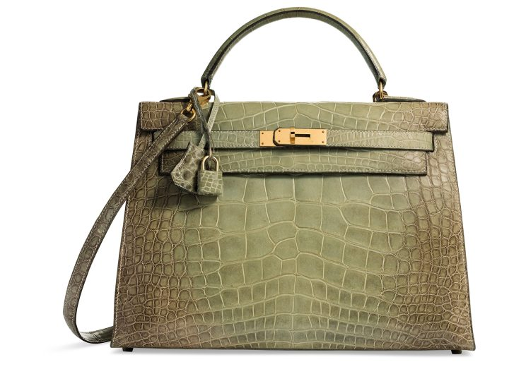 A rare, shiny natura vert céladon alligator Sellier Kelly 32 with gold hardware Hermès (1995), 32 w x 23 h x 11 d centimeters, includes lock, keys, clochette, shoulder strap, dustbag, and box (image courtesy Christie's)