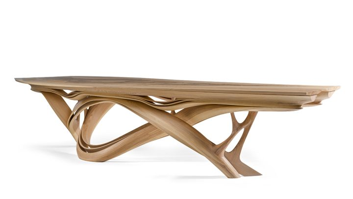 """Joseph Walsh, unique """"Enignum X"""" dining table with engraved copper plaque (2013), olive ash, burr olive ash, white oil, 29 1/2 x 141 3/4 x 57 1/8 inches, produced by Joseph Walsh, County Cork, Ireland (image courtesy Sotheby's)"""