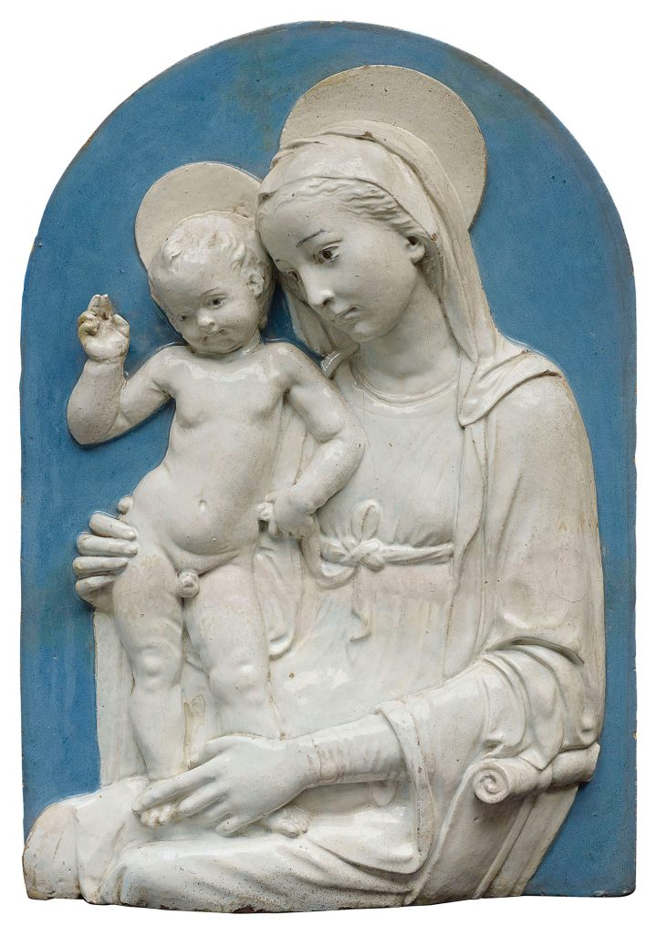 """Andrea Della Robbia, """"The Virgin and Child"""" (c. 1485), blue and white glazed terracotta relief, in a later parcel-gilt wood frame, 18 x 12 inches, 26 1/2 x 19 inches, overall (image courtesy Christie's)"""