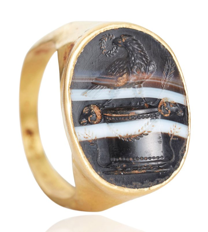 A Roman gold and banded agate finger ring with an eagle on altar (c. 1st century BCE) (image courtesy Christie's)