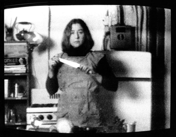 "Martha Rosler, still from ""Semiotics of the Kitchen"" (1975), black-and-white video, 6 min., 30 sec. (artwork © Martha Rosler)"