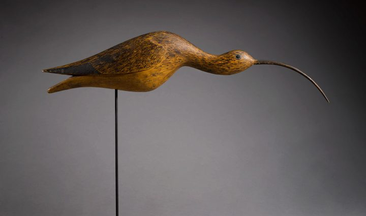 Long-Billed Curlew (1880–90), American School, 19th century, polychromed wood decoy with wax eye, height 4 3/4 inches by length 21 1/2 inches, Salem, Massachusetts area (image courtesy Sotheby's)