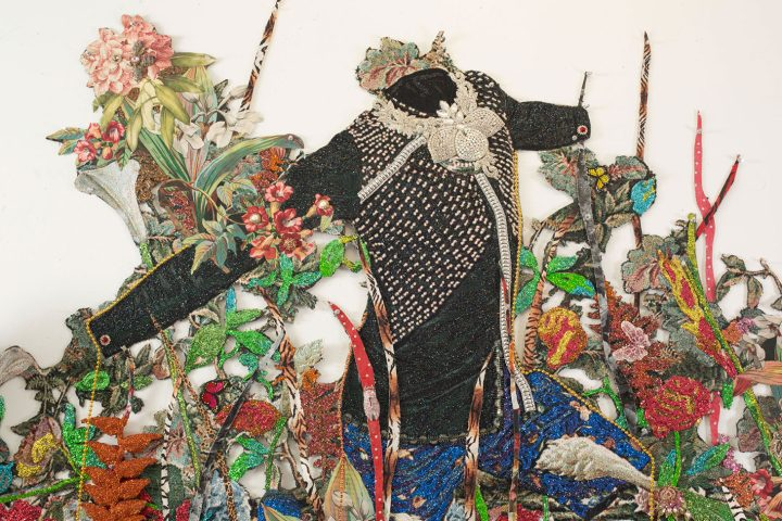 """Ebony G. Patterson, """"… a wailing black horse … for those who bear/bare witness"""" (2018), detail, hand cut jacquard photo tapestry with glitter, appliques, pins, embellishments, fabric, tassels, brooches, acrylic, glass pearls, beads, hand cast embellished heliconias, shelf, embellished resin owl, and artist-designed fabric wallpaper (not pictured) (image courtesy the artist and Monique Meloche Gallery, Chicago)"""