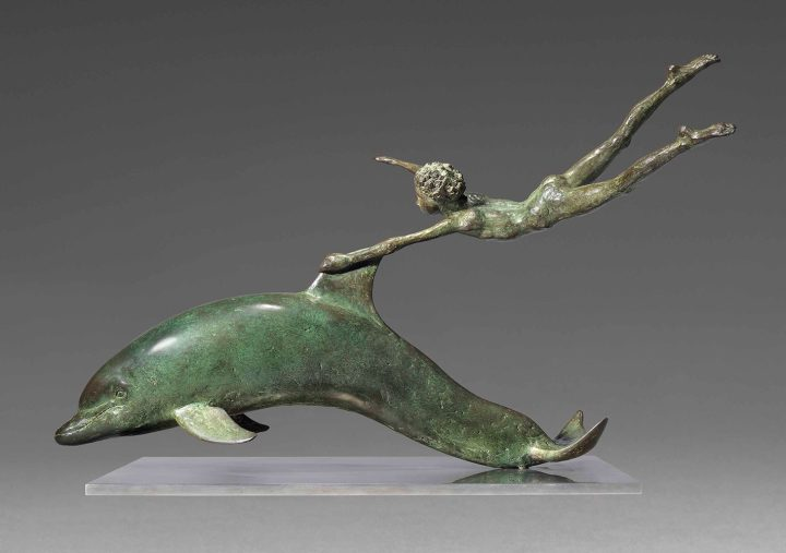 "David Wynne, ""Boy with a Dolphin"" (1972), bronze with a green/brown patina, 23 3/4 inches long, excluding metal base (image courtesy Christie's)"