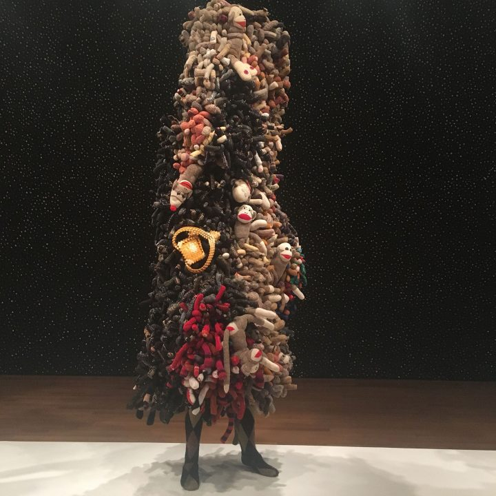 "Nick Cave, ""Soundsuit"" (2013), mixed media, including sock monkeys, sweaters, and mannequin, 105 x 48 x 36 inches"