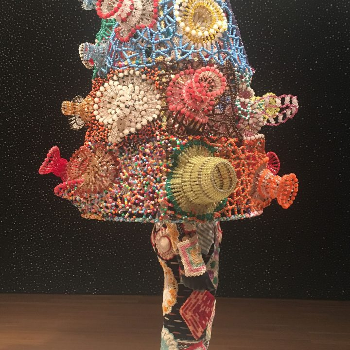 "Nick Cave, ""Soundsuit"" (2013), mixed media, including vintage bunny, safety pin craft baskets, hot pads, fabric, metal, and mannequin