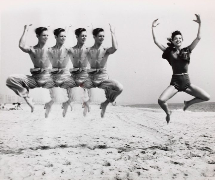 """Weegee, """"Jumping on Beach"""" (c. 1955), gelatin silver print, image: 7 3/4 x 9 1/2 inches, sheet: 8 1/4 x 10 inches (image courtesy Christie's)"""