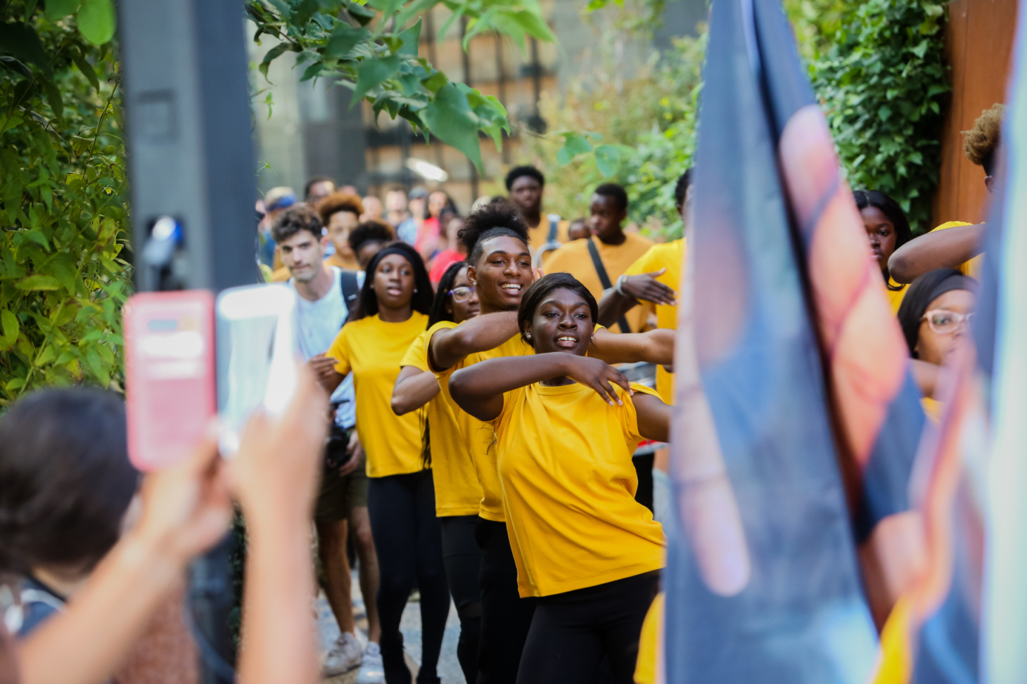 A group of young Black steppers performs on the high line.