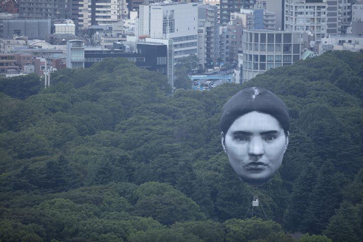 Giant Balloon Face Floats Over Tokyo